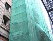 Фасадная сетка – это тоже вид временного ограждения